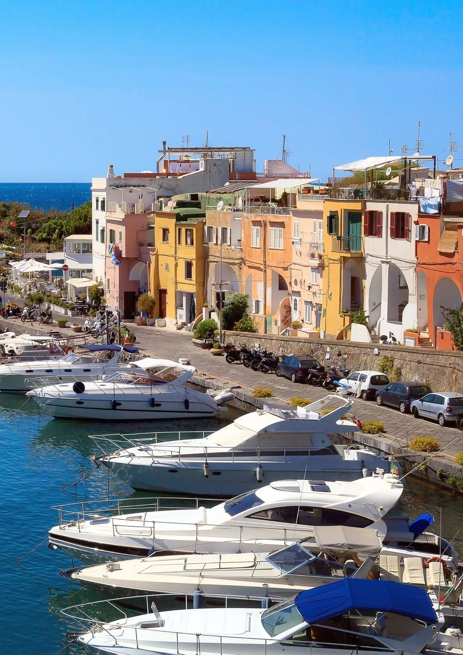 View of the colorful harbour of Chiaiolella Marina in Procida