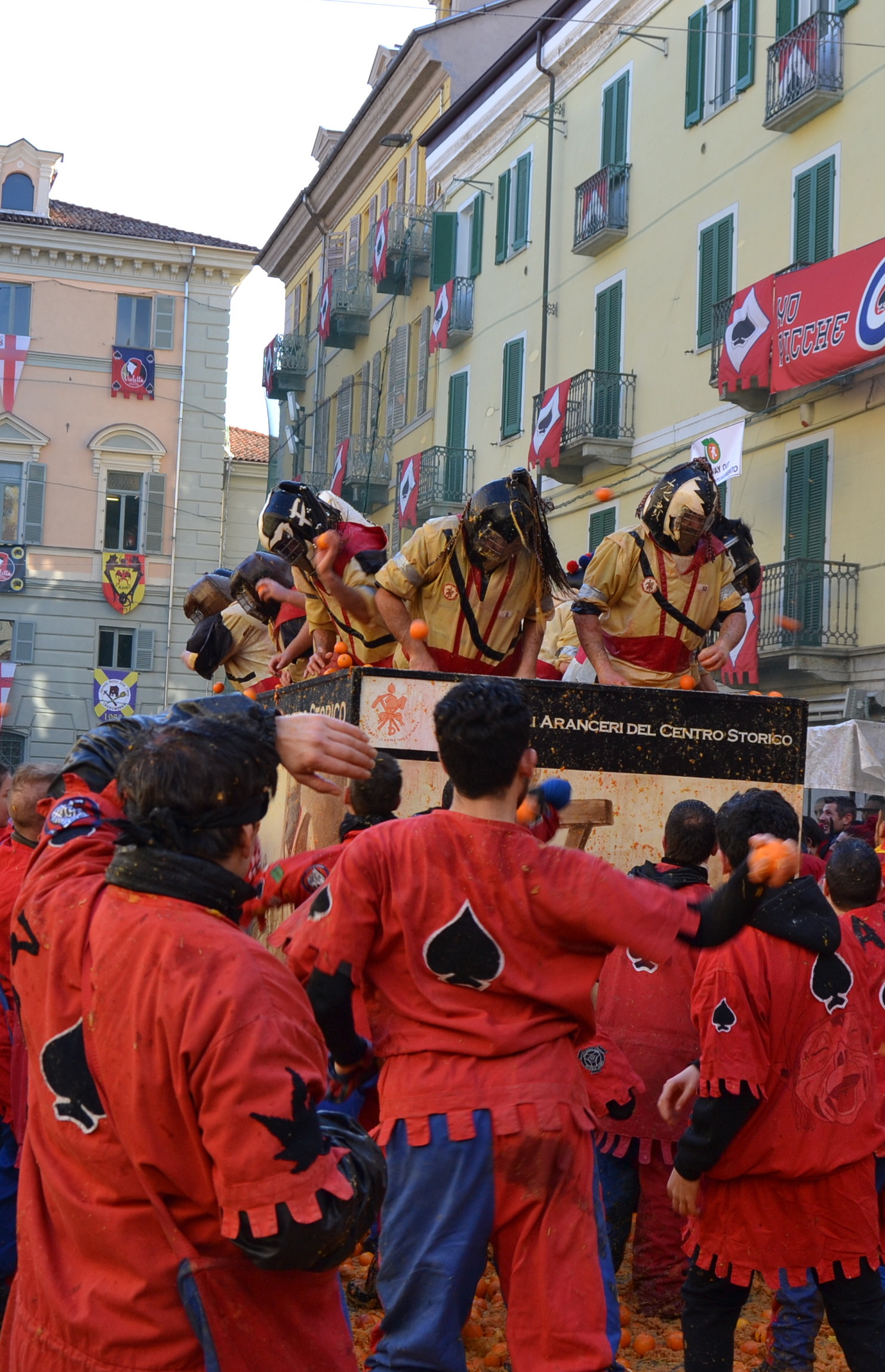 Orange throwers at the battle of the oranges in Ivrea, one of Italy's most spectacular Carnival celebrations