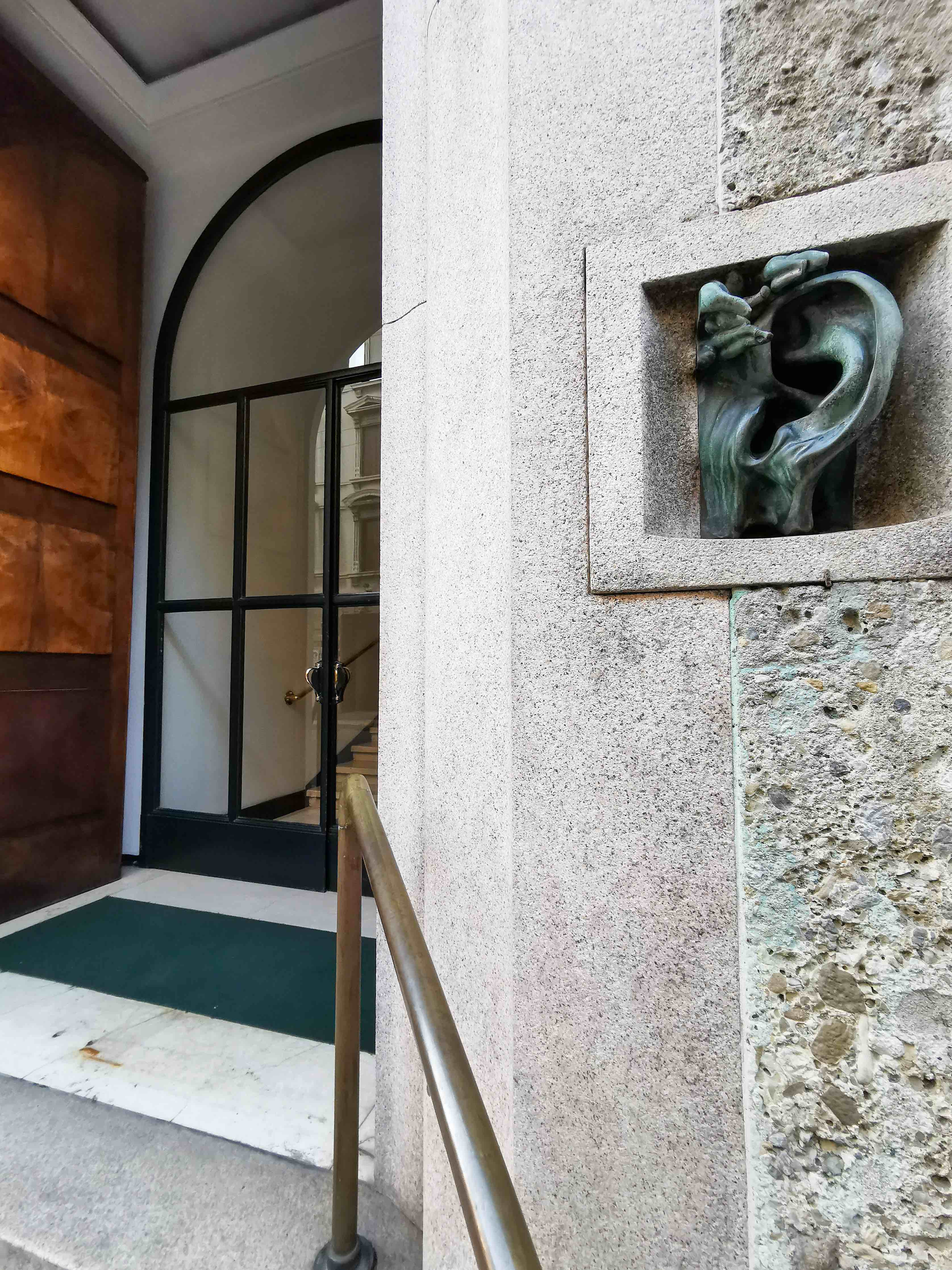 The giant ear at the entrance of Casa Sola-Brusca in Milan