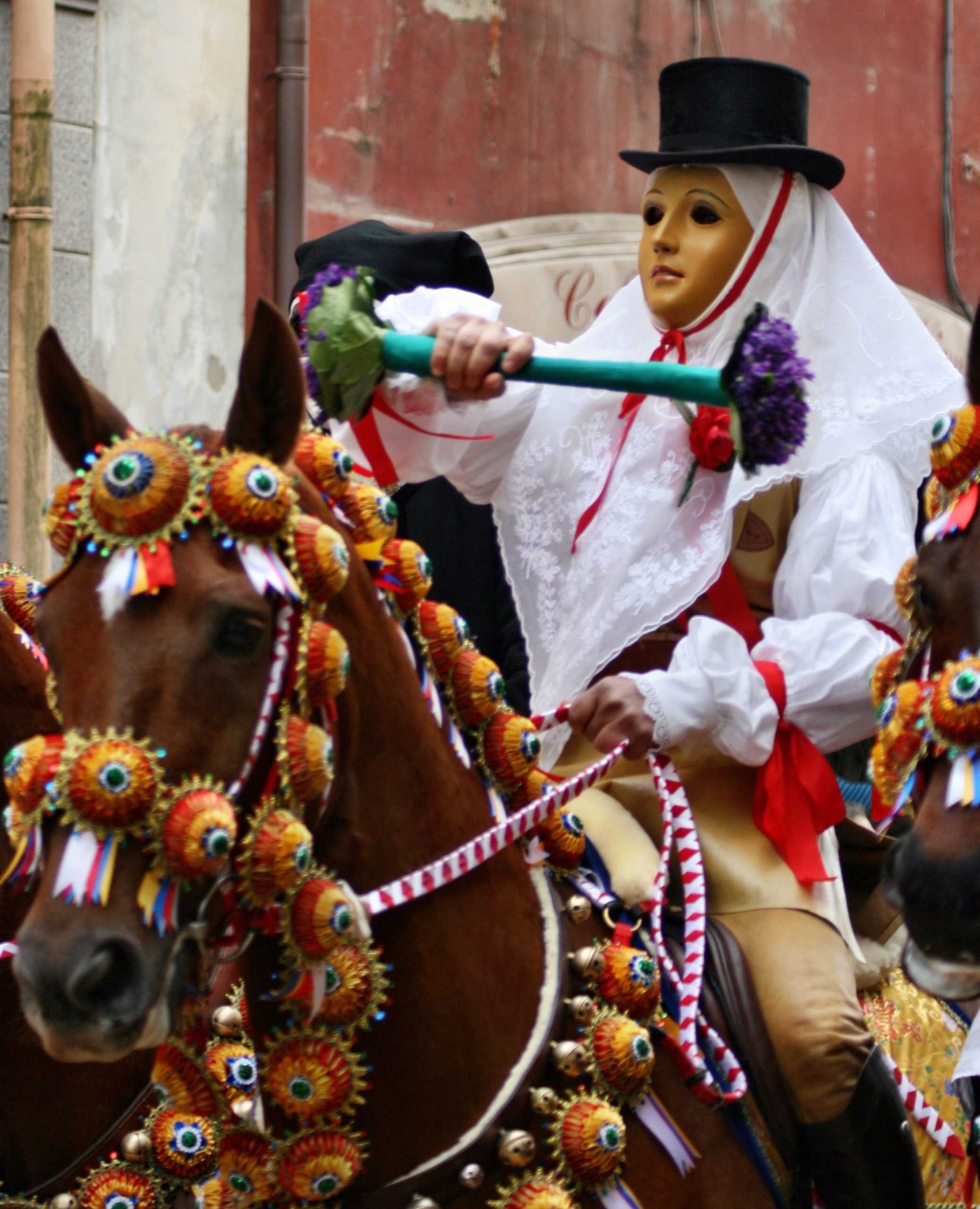 Man on horse dressed up in traditional costumes at the Carnival festival of Sartiglia in Sardinia
