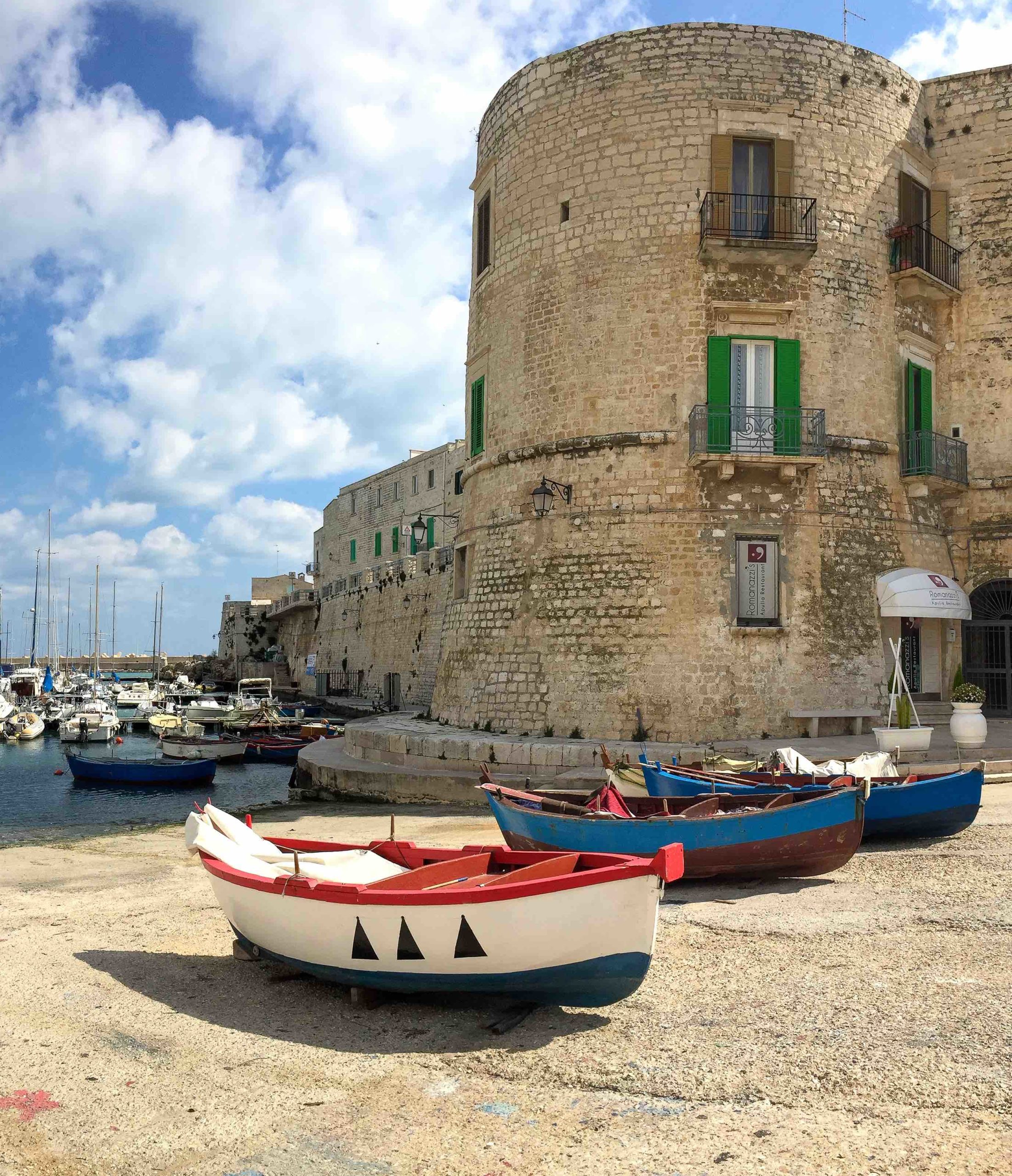 Colorful fishing boats in Giovinazzo, a charming village in the region of Apulia