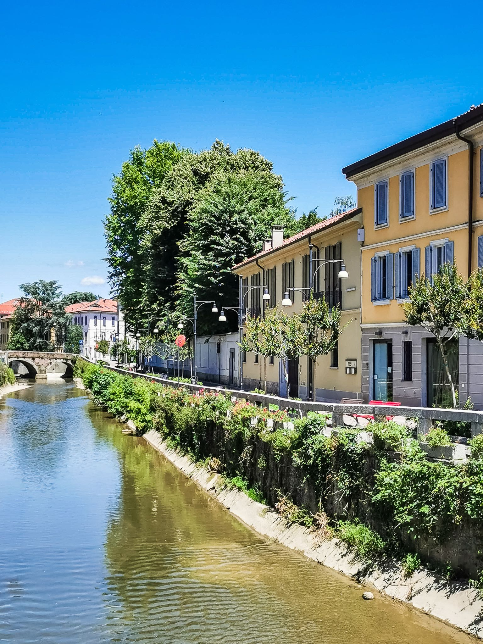 The quaint riverfront footpath in Monza historic center