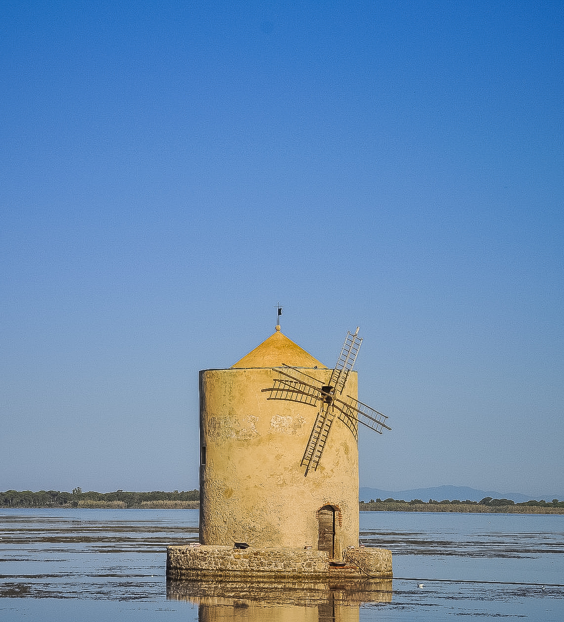 The windmill on the lagoon of Orbetello in Tuscany