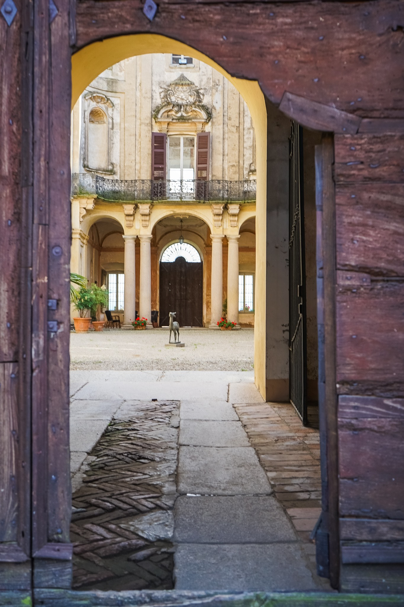 The charming baroque courtyard inside the Castle of Chignolo Po in Lombardy