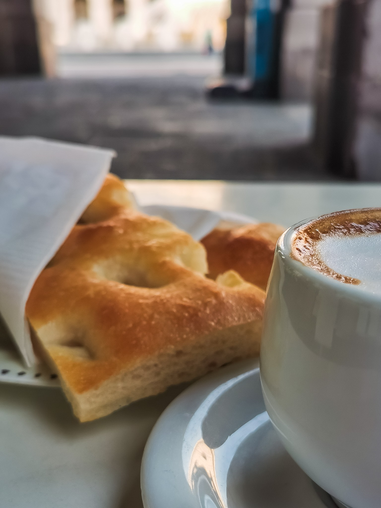 Cappuccino and focaccia, the typical breakfast in Genoa