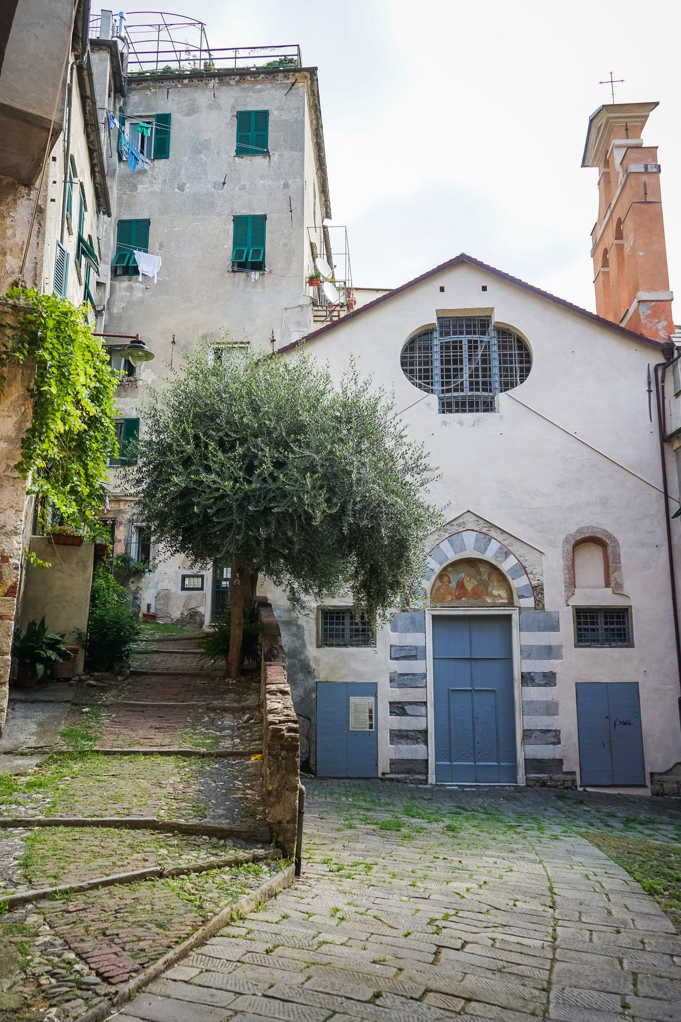 The ancient church of piazza San Bartolomeo dell'Olivella, an atmospheric corner in the Carmine neighbourhood in Genoa