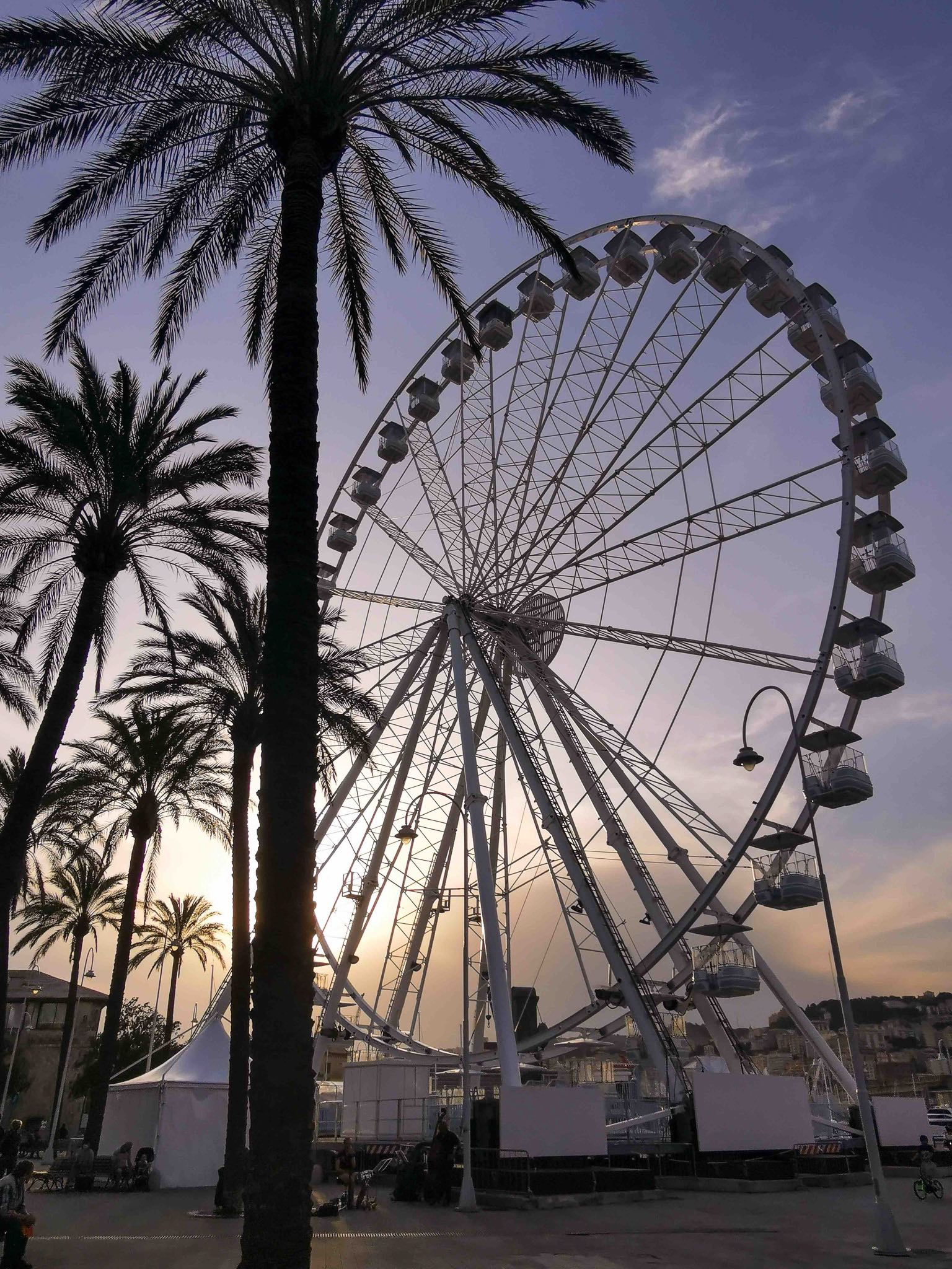 The ferris wheel at Genoa old port at sunset
