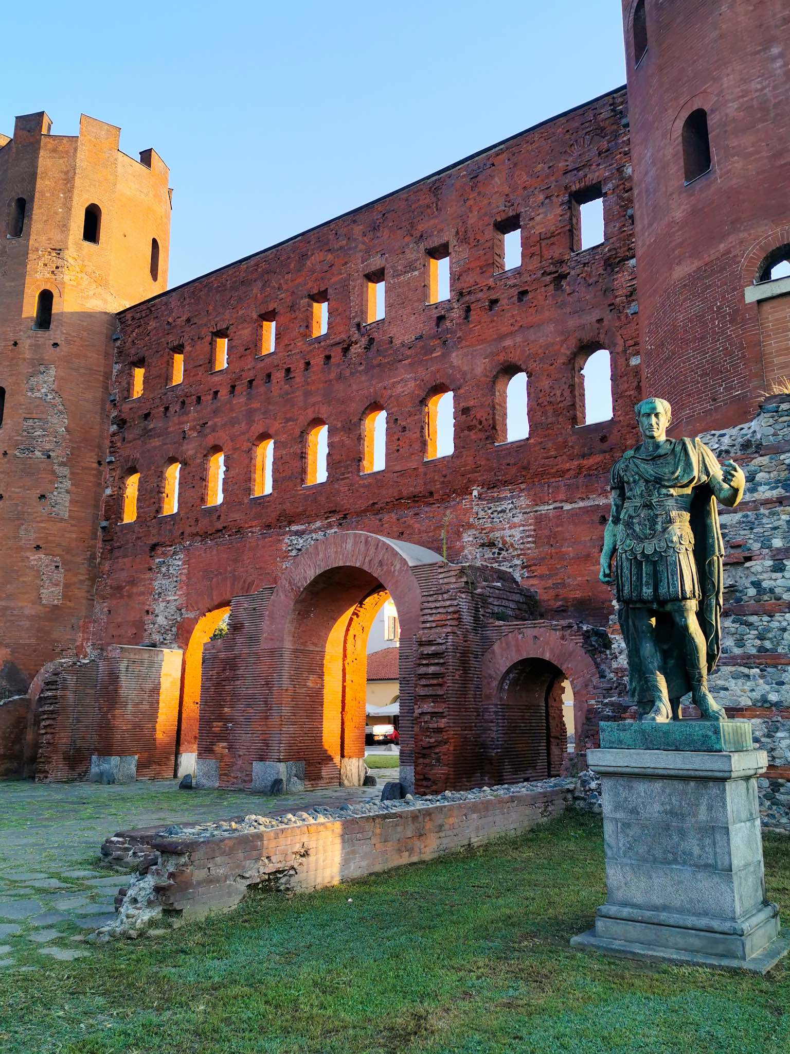 Turin's Porta Palatina, a beautifully preserved red-brick Roman gate guarded by the statues of Augustus and Caesar