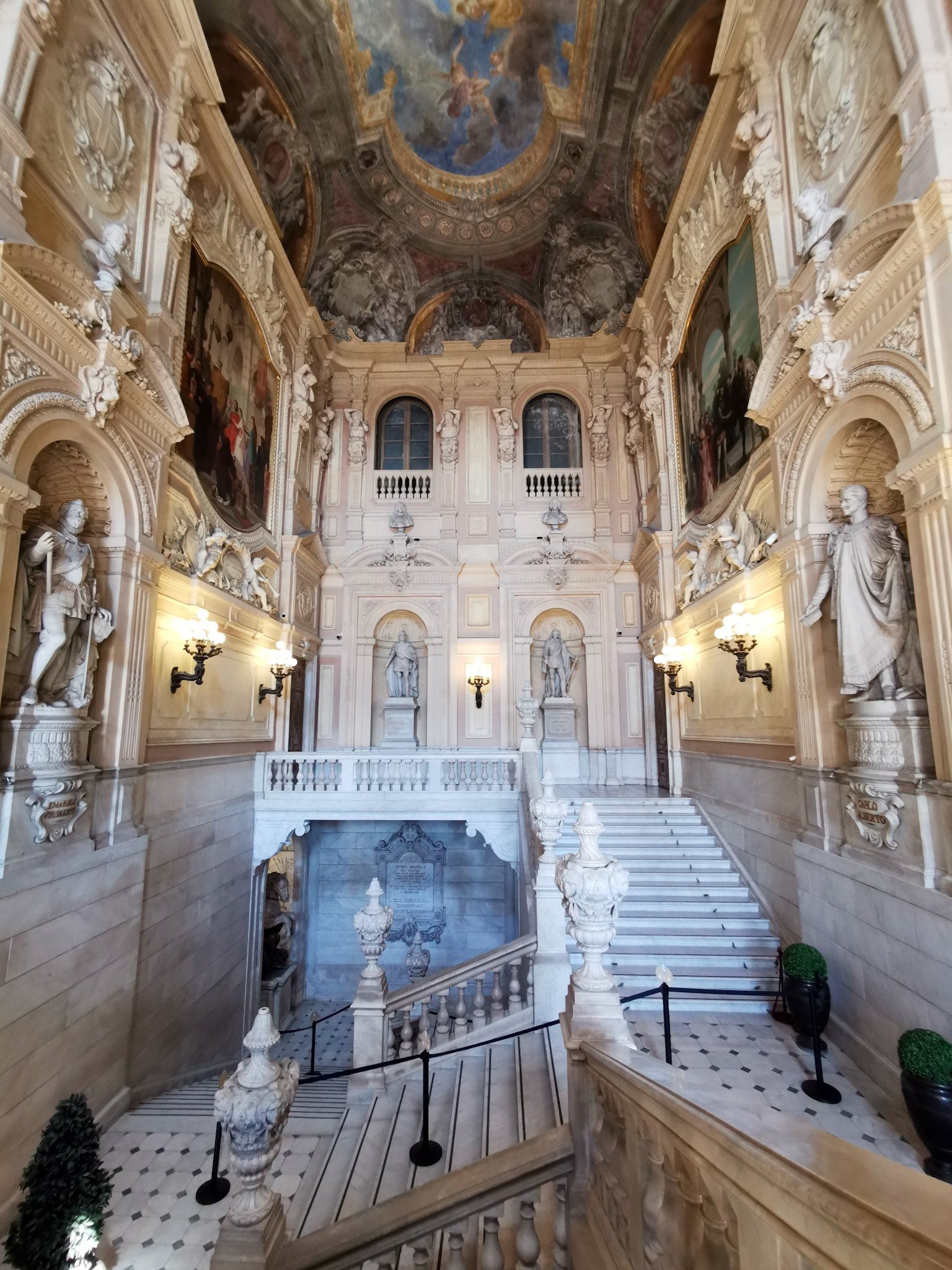 The grandiose staircase that welcomes you at the entrance of the Royal Museums in Turin