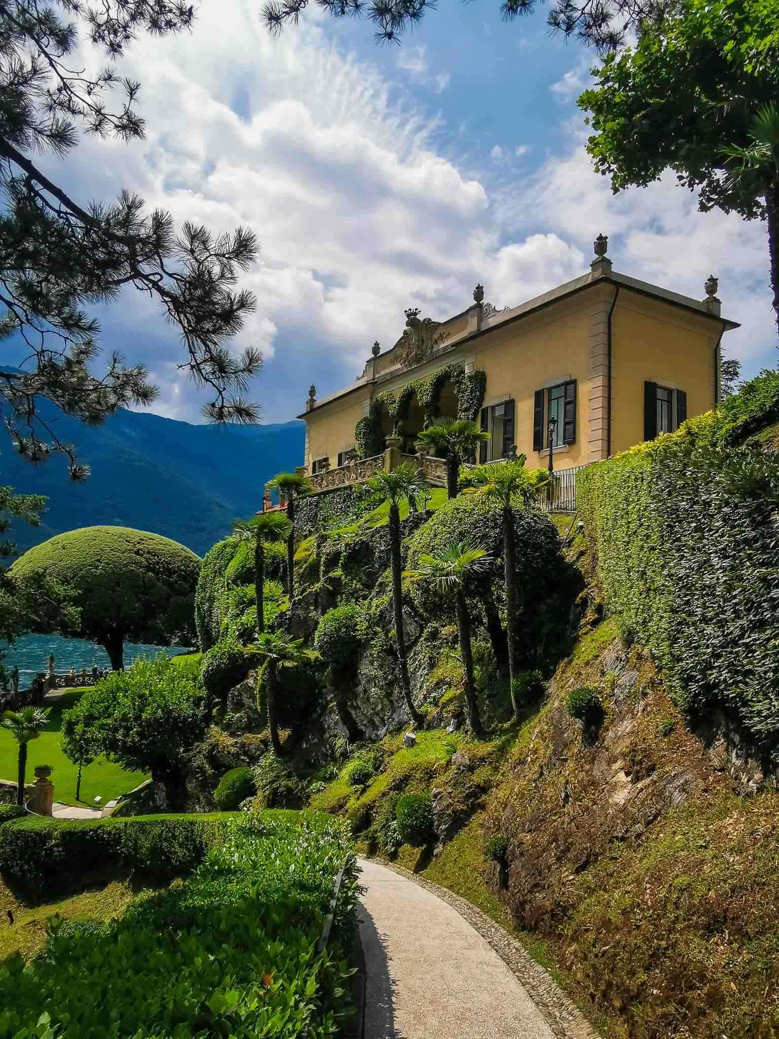 The splendid gardens of Villa del Balbianello, with the ancient holm oak pruned in a curious umbrella shape