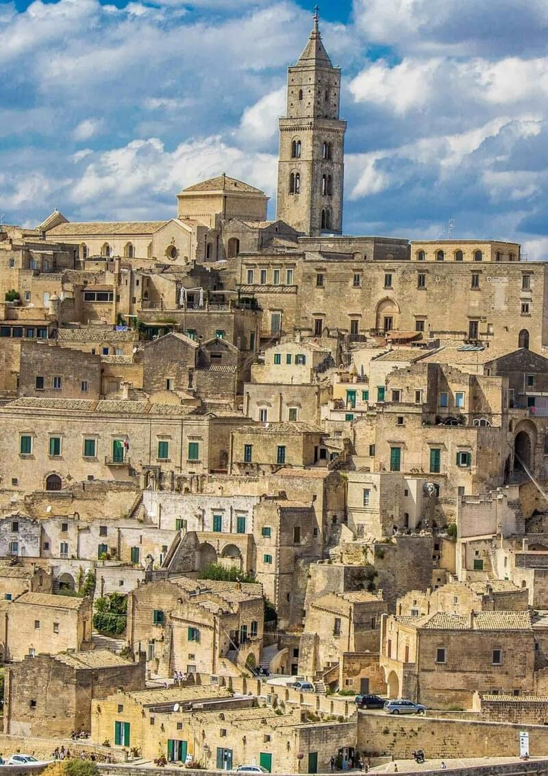 A view of the ancient cave town of Matera in Basilicata with a jumble of honey-coloured buildings