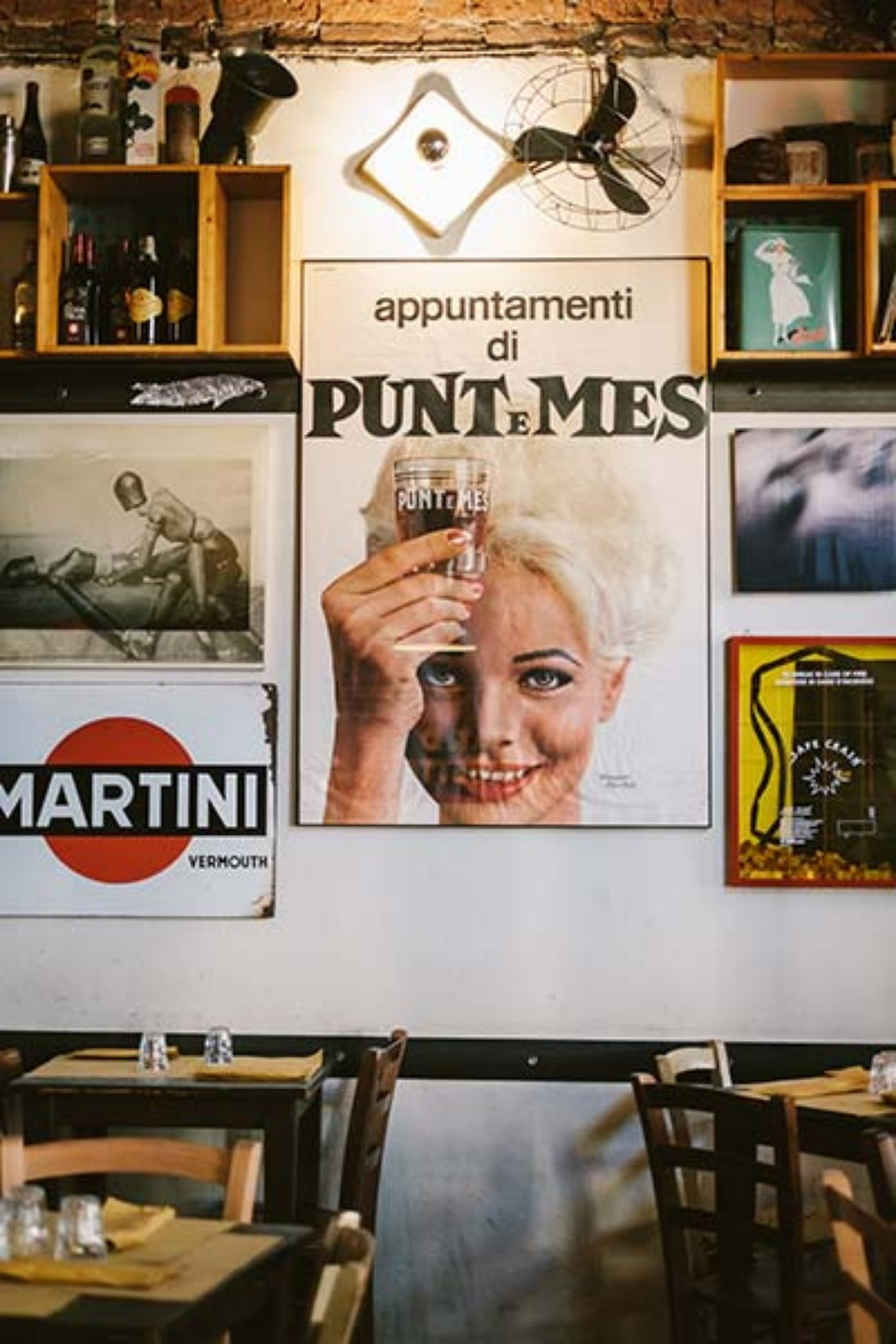 vintage posters and period objects inside piola da cianci in turin