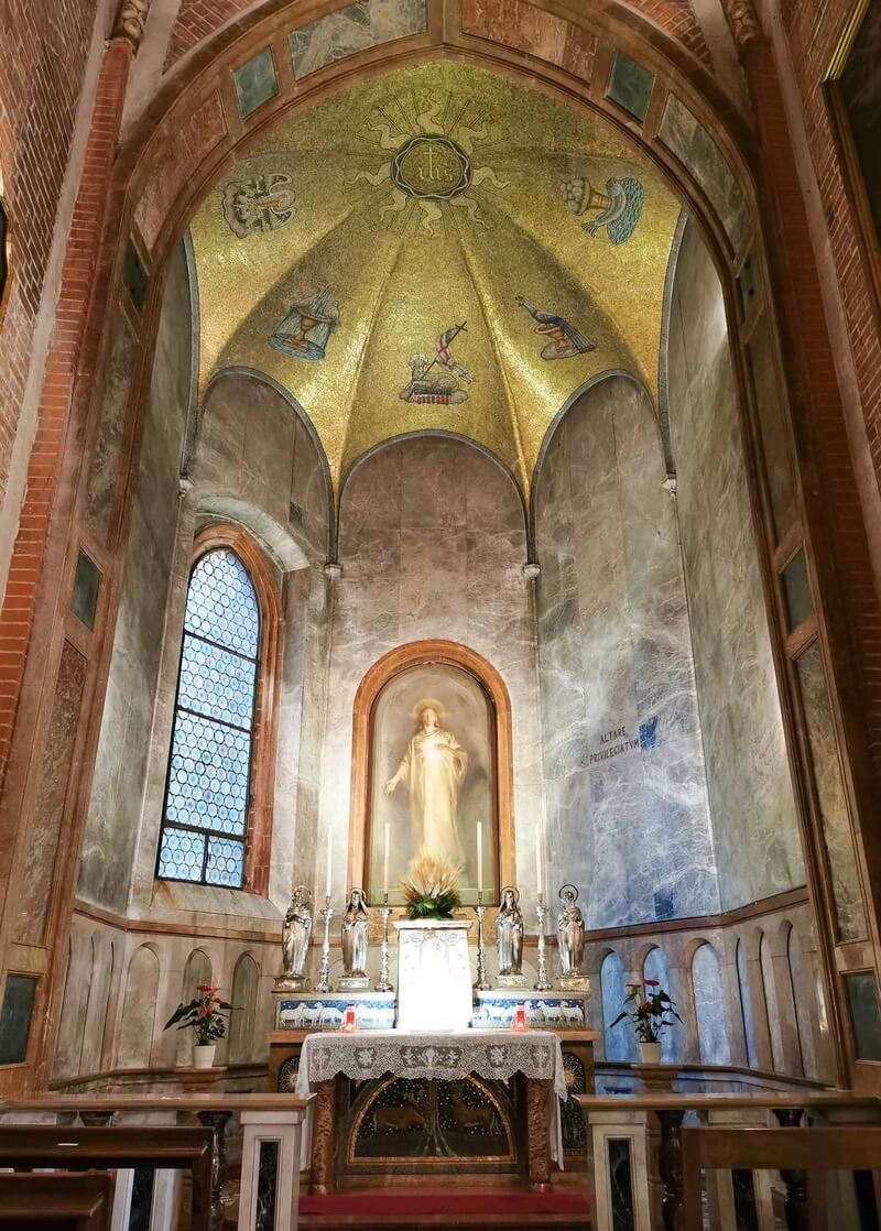 One of the chapels inside the Basilica of San Lorenzo in Mortara, with golden ceiling and a beautiful fresco