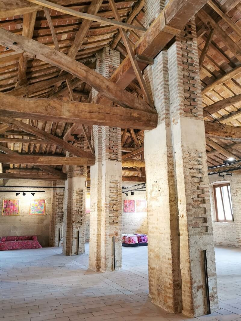The splendid wooden trusses and brick walls inside the Pila of Sartirana, a former warehouse for rice storage
