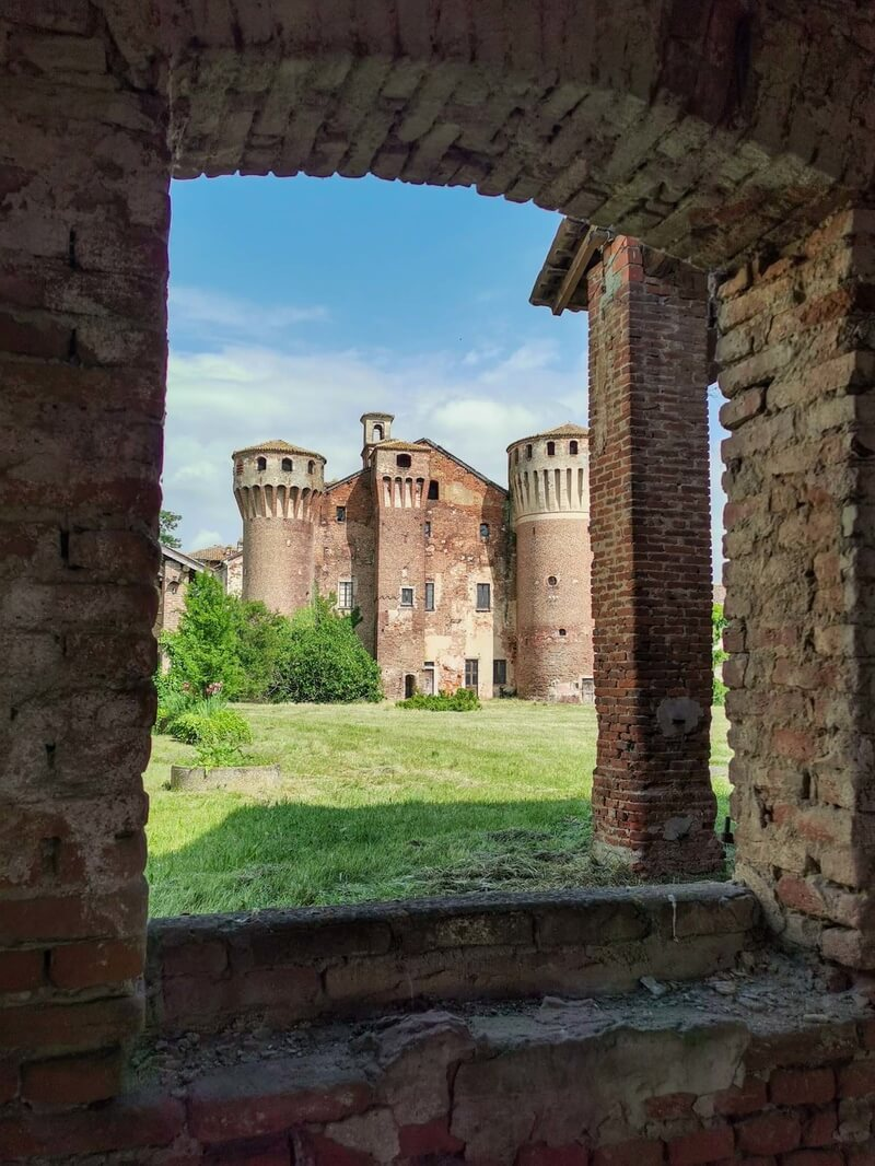 The medieval castle of Valeggio as seen from an ancient, red-bricked window
