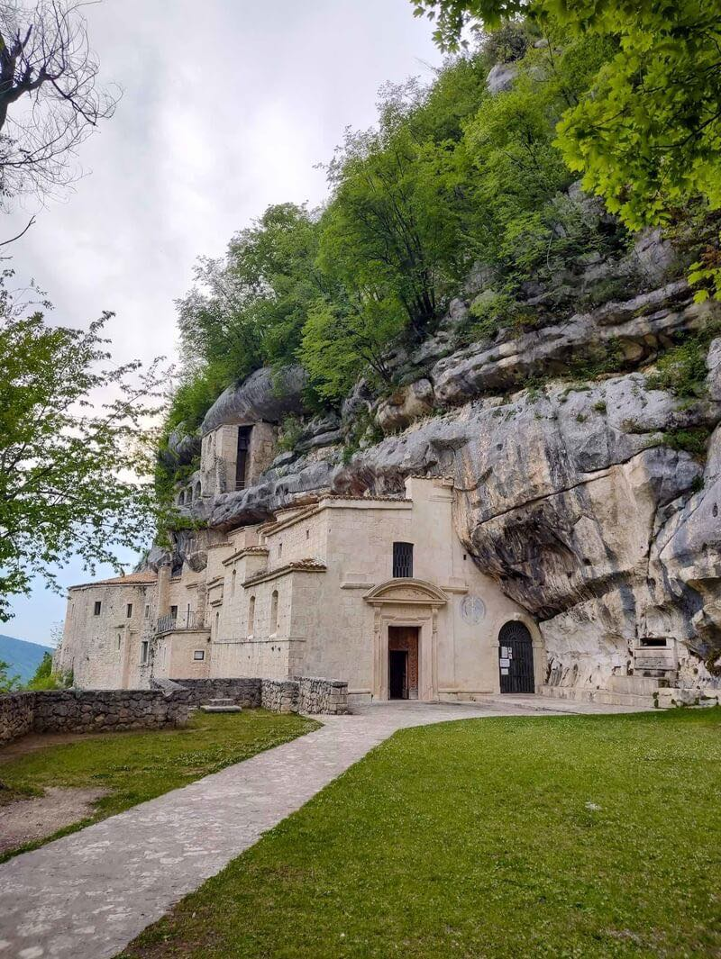 a monastery built into the side of a mountain in the Majella National Park in Abruzzo